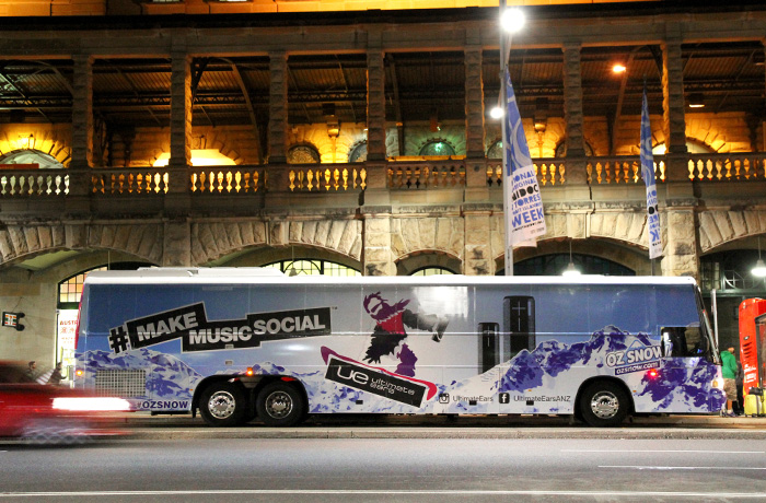 Brand strategy agencies. The fully wrapped bus in motion.