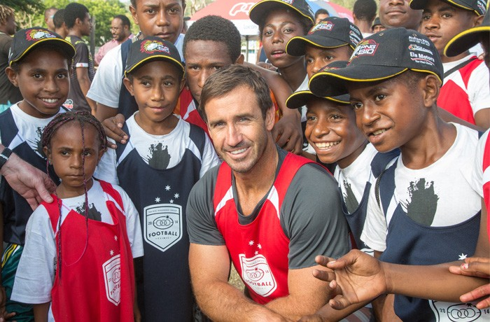 Decorated Aussie halfback Andrew Johns posing with clinic attendees.