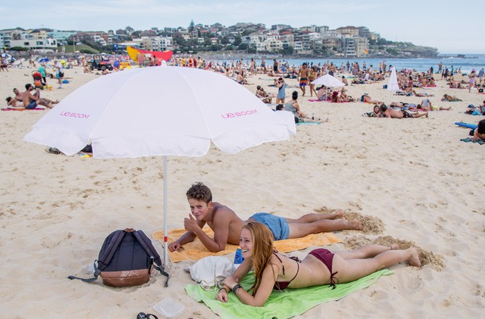 UMM organised event merchandise, like beach umbrellas and towels, to give to beachgoers on the day.