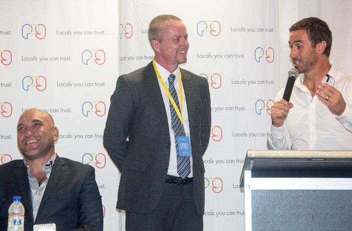 UMM PNG MD Glen Scott shares a laugh with Andrew Johns..