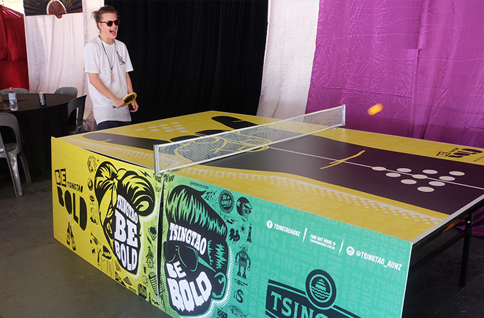 The Tsingtao Be Bold Ping Pong Table backstage at FOTSUN, with Ivan Ooze on paddle patrol.